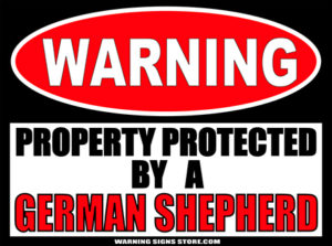 GERMAN SHEPHERD PROPERTY PROTECTED BY WARNING SIGN
